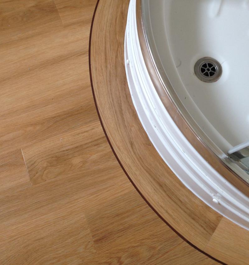 View our work for Luxury vinyl bathroom flooring
